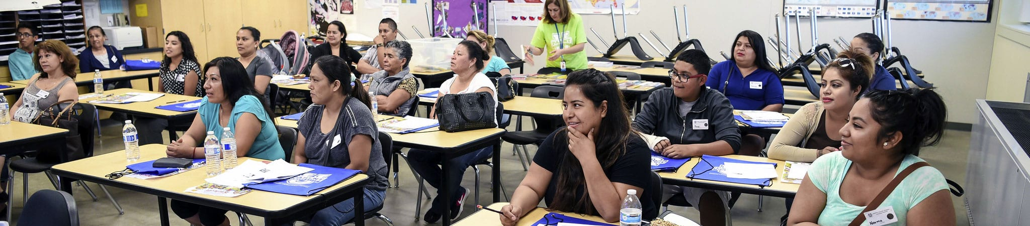 A classroom of English learners and their families.